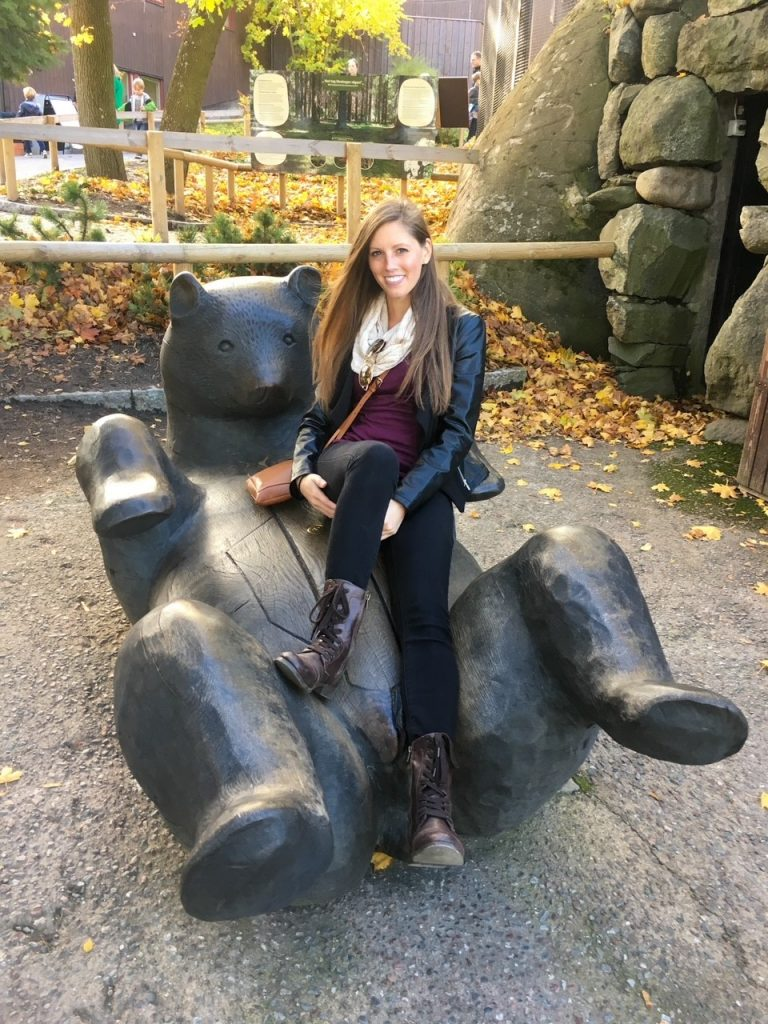 playing on the wooden bear at Skansen